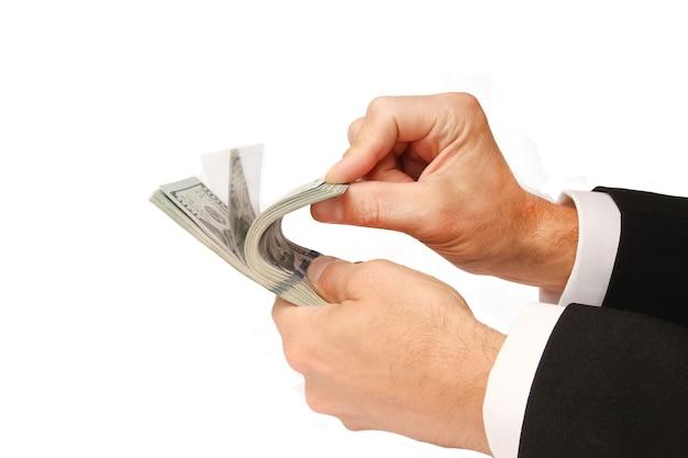 Geschäftsgeld dollar in den händen auf einer weißen oberfläche