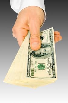 Geschäftskonzept mit dollargeld mit der hand