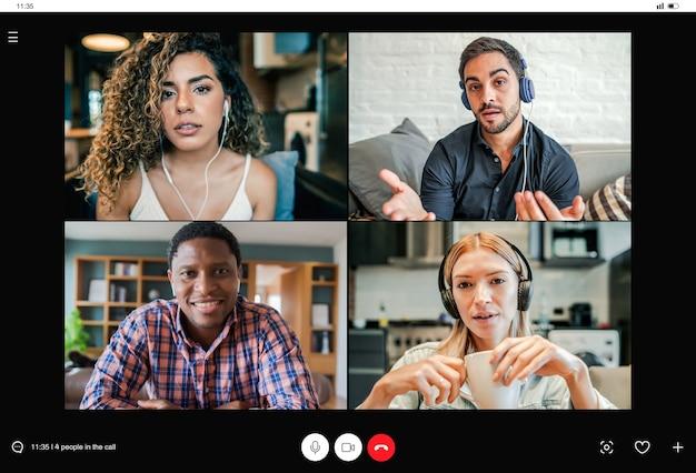 Geschäftsleute treffen sich zu einem videoanruf, während sie aus der ferne arbeiten. telefonkonferenz zur telearbeit. neues normales lifestyle-konzept.