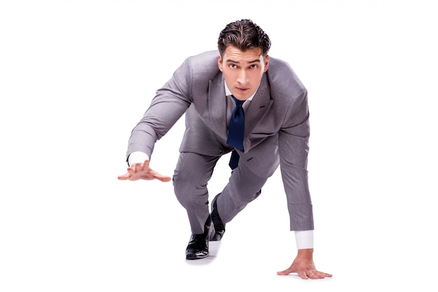 Geschäftsmann auf dem anfang bereit zum laufen lokalisiert auf weiß