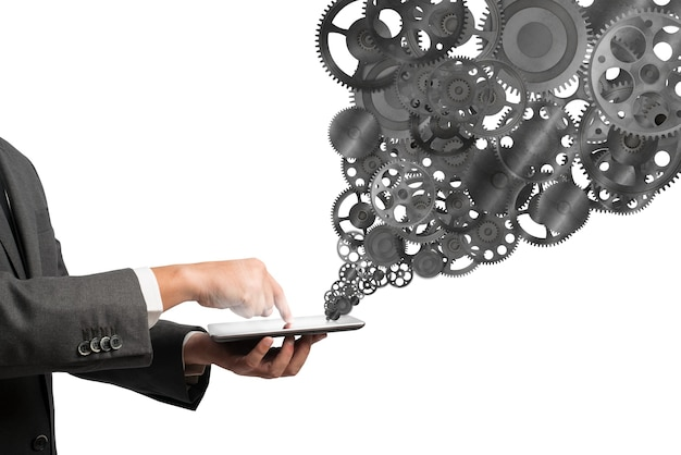 Geschäftsmann berühren einen tablet-bildschirm mit zahnradmechanismus