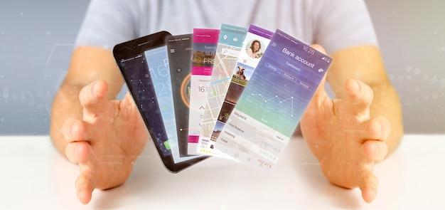 Geschäftsmann, der bewegliche anwendungsschablone auf einer wiedergabe des smartphone 3d hält