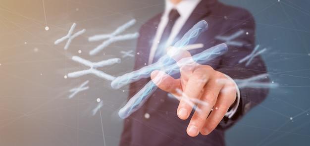 Geschäftsmann, der eine gruppe des chromosoms mit dna innerhalb der lokalisierten wiedergabe 3d hält