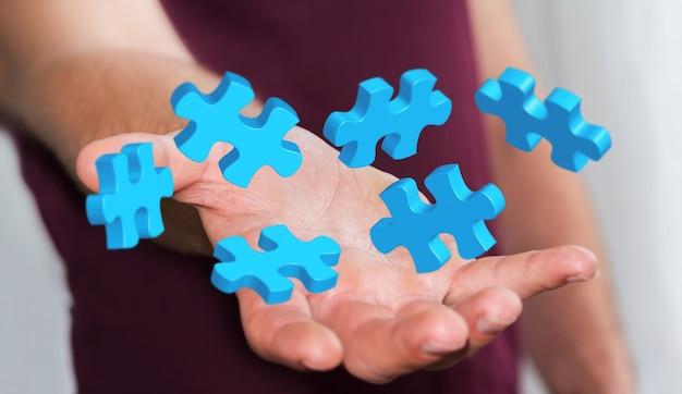 Geschäftsmann, der fliegende puzzlespielstücke hält