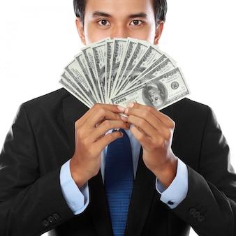 Geschäftsmann, der geld hält