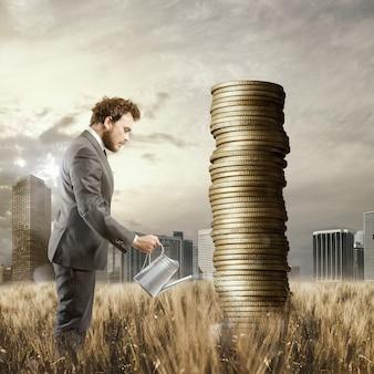 Geschäftsmann, der geldmünzen gießt, als ob sie pflanzen wären