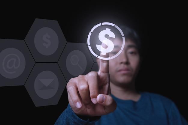 Geschäftsmann, der geldwährungssymbol mit finger berührt. konzept über globale finanzen.