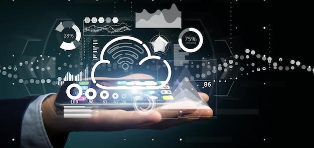 Geschäftsmann, der wolken- und wifi-konzept mit ikone, statistiken und wiedergabe der daten 3d hält