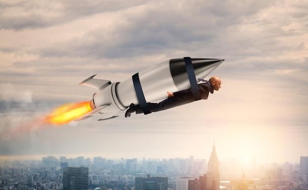Geschäftsmann fliegt mit einem schnellen raketenkonzept von ehrgeiz und entschlossenheit