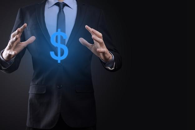 Geschäftsmann hält dollarzeichen