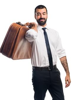Geschäftsmann hält eine aktentasche