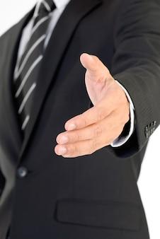 Geschäftsmann hand schütteln und sie begrüßen.
