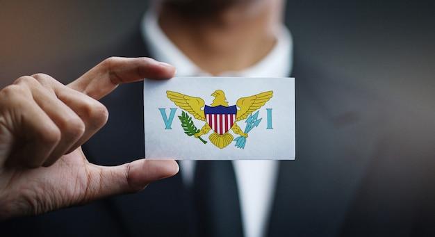 Geschäftsmann holding card von amerikanische jungferninseln flagge