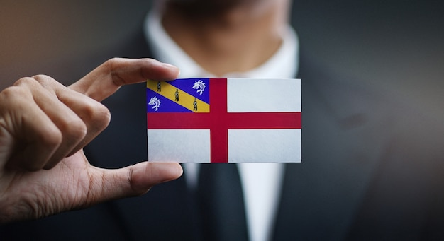 Geschäftsmann holding card von herm flag