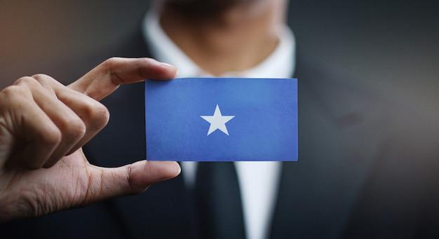 Geschäftsmann holding card von somalia flagge
