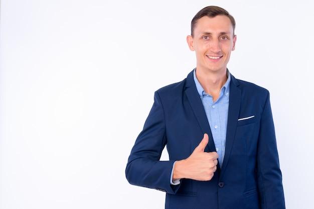 Geschäftsmann tragen anzug isoliert gegen weiße wand