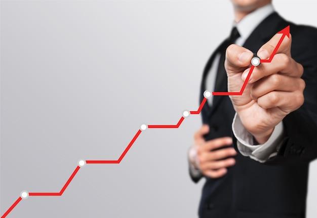 Geschäftsmann und wachsende linie symbolisieren wachsende fähigkeiten