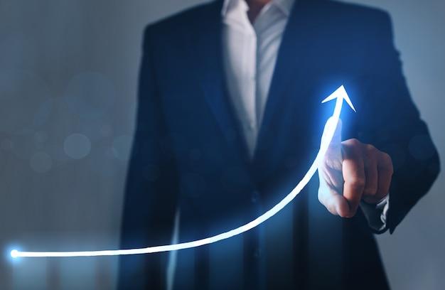 Geschäftsmannfinger, der pfeilgraph mit diagramm zeigt. geschäftsplanung und strategiekonzept.