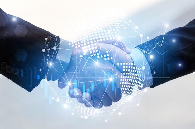 Geschäftsmannhändedruck mit globaler weltkartennetzwerkverbindungsverbindung des effektes und diagrammdiagramm des grafischen diagramms der börse