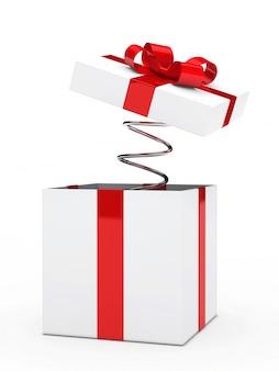 Geschenk mit roter schleife und eine feder