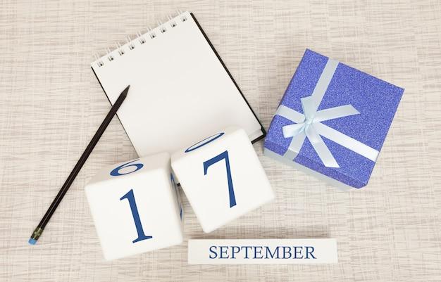 Geschenkbox und holzkalender mit trendigen blauen zahlen, 17. september