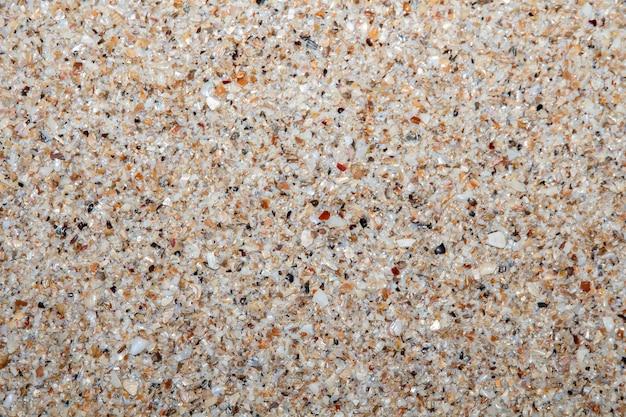 Geschlossen herauf das sandsteinkies-beschaffenheitsmuster, das für dekorationshintergrund benutzt wird