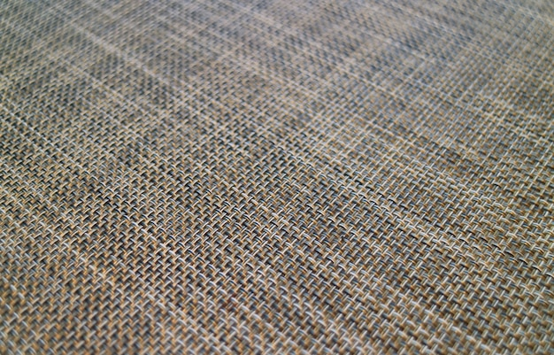Geschlossen herauf diagonales korbgeflechtmuster einer mittagessenmatte für hintergrund