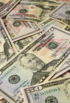 Geschlossen herauf haufen von fünfzig dollarscheinen vereinigter staaten, vertikales foto für hintergrund