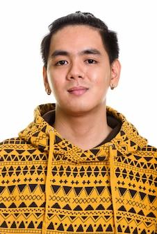 Gesicht des hübschen asiatischen mannes mit zurückgebundenen haaren
