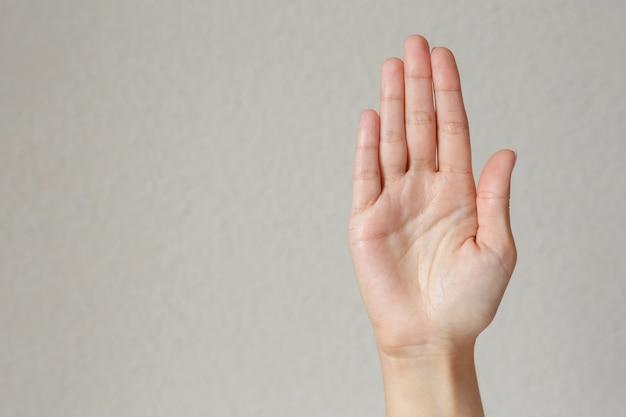 Geste und zeichen, weibliche hand zeigt halt