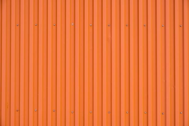 Gestreifte beschaffenheit und hintergrund der orange behälterreihe