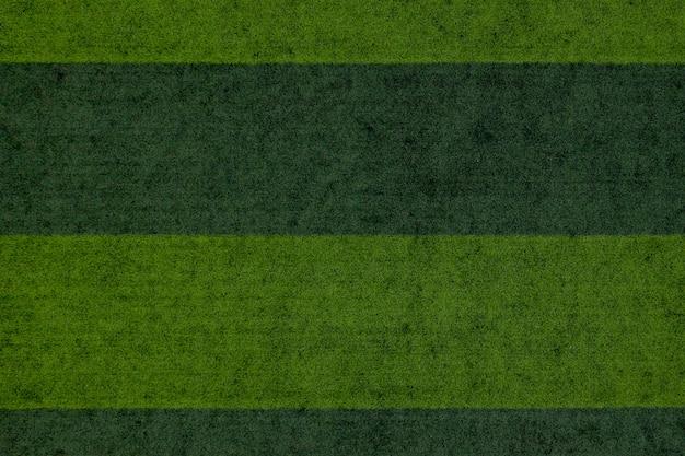 Gestreifter fußballfeldhintergrund, grüner grasfußballfeldhintergrund
