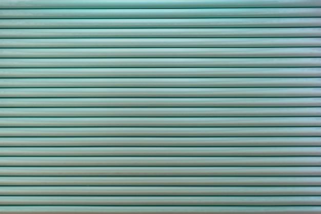Gestreifter hintergrund. horizontale struktur von wiederholten grünen rollen.