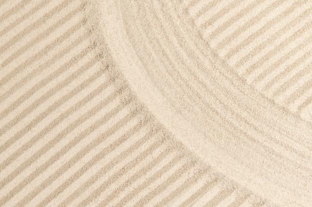 Gestreifter zen-sand-hintergrund im achtsamkeitskonzept