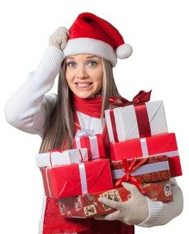 Gestresste frau mit weihnachtsgeschenken - isoliert