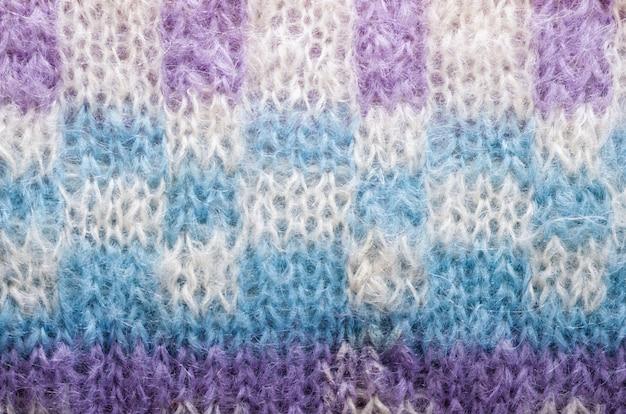 Gestrickte textur. musterstoff aus wolle. hintergrund, raum kopieren