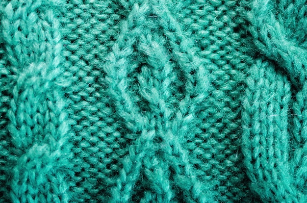 Gestrickte textur. musterstoff aus wolle. türkis hintergrund