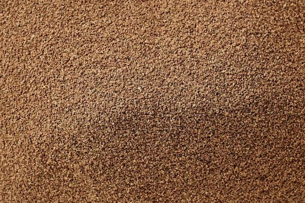 Gesunder trockener organischer selleriesamenhintergrund, der details und beschaffenheit zeigt