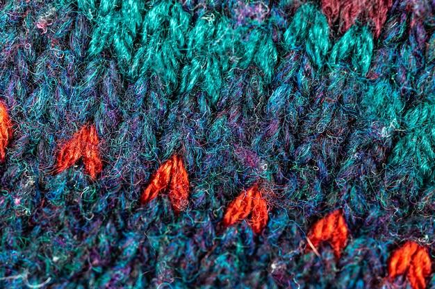Gewebter textilhintergrund, warme und bunte pulloverbeschaffenheit aus wolle und musterhintergrundnahaufnahmefoto