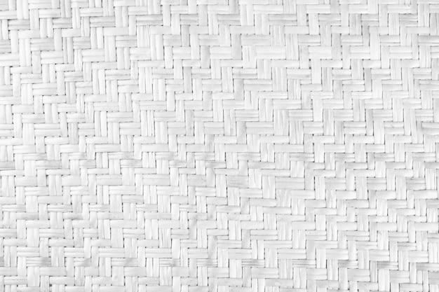Gewebter weißer rattantexturhintergrundhandwerkswebenbeschaffenheit natürliches weidengeflecht
