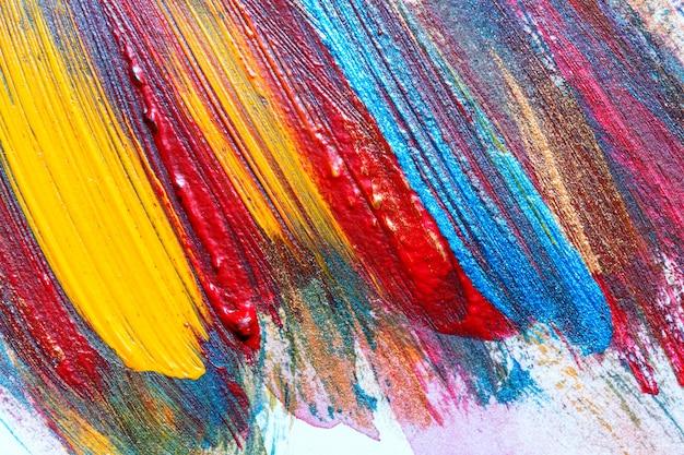 Gezeichnete acrylmalerei des kreativen kunsthintergrundes hand. nahaufnahme schoss von der acrylfarbe der bunten beschaffenheit der pinselstriche auf segeltuch. moderne zeitgenössische kunst. abstrakte komposition für design-elemente.
