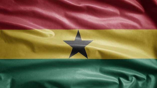 Ghanaische flagge weht im wind. nahaufnahme von ghana banner weht, weiche und glatte seide. stoff textur fähnrich hintergrund. verwenden sie es für das konzept für nationalfeiertage und länderanlässe.