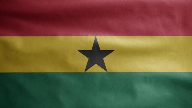 Ghanaische flagge weht im wind. nahaufnahme von ghana banner weht, weiche und glatte seide. stoff textur fähnrich hintergrund.
