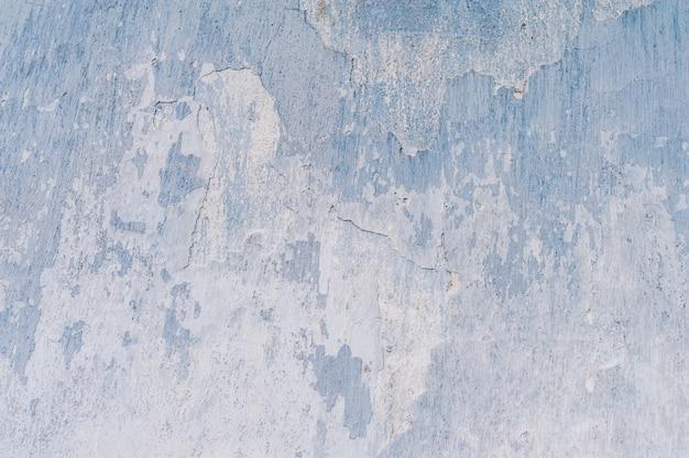 Gips von blau und weißdie textur der alten rissigen farbe an der wand.