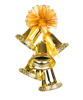 Glänzende goldene weihnachtsglocken verziert