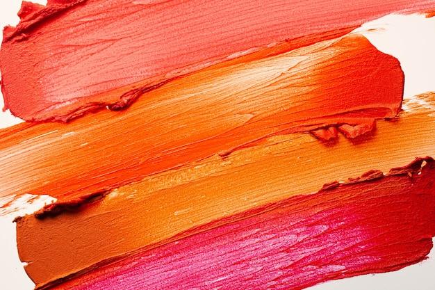 Glänzende mehrfarbige lippenstift-hintergrundtextur verschmiert