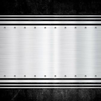 Glänzende metallplatte auf einem schmutzhintergrund