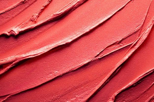 Glänzende rote lippenstift-hintergrundtextur verschmiert