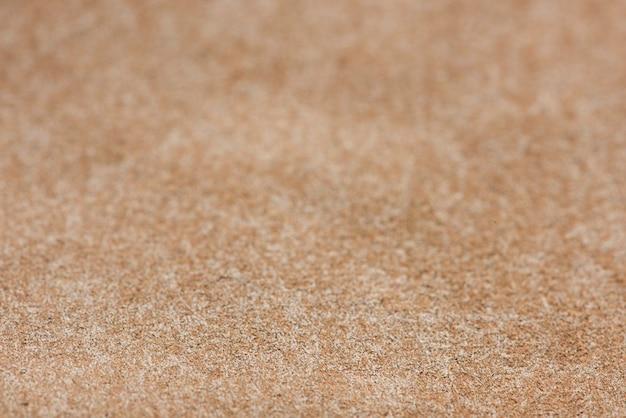 Glänzender bronzefarbener strukturierter papierhintergrund