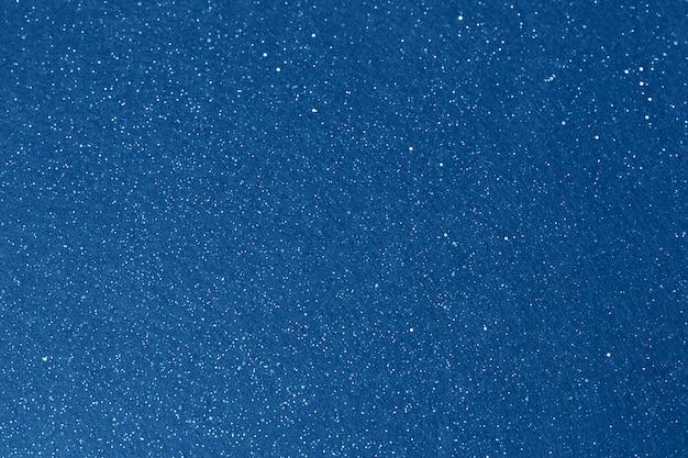 Glänzender funkelnhintergrund des blauen himmels. abstrakter hintergrund